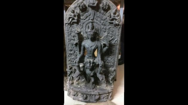 A 1200AD statue of Lord Vishnu sitting over Garuda is among the antiques recovered in India before they were to be shipped out to the United States.(HT PHOTO)