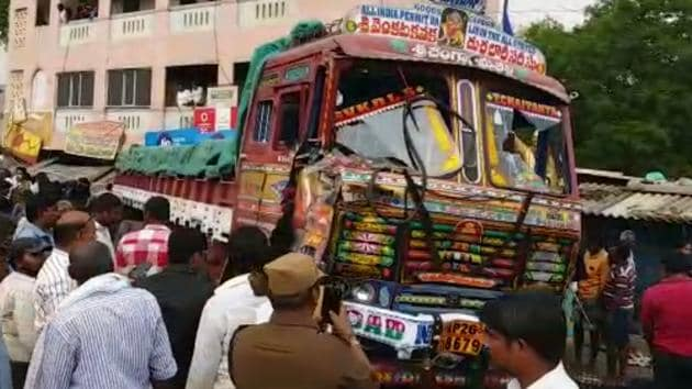 People near the truck that lost control and led to the tragedy that killed 20 people in Andhra Pradesh on Friday.(WhatsApp video grab)