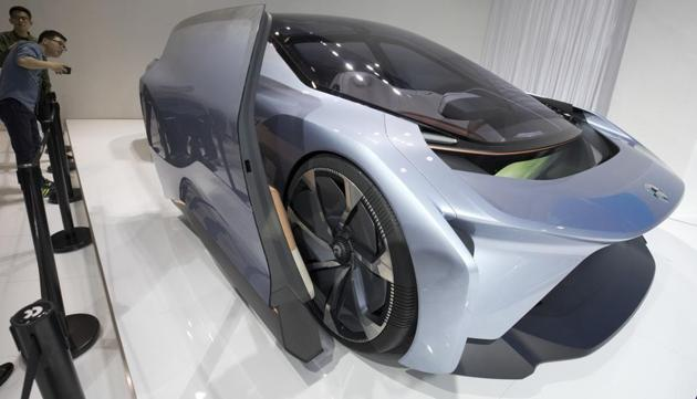 Visitors look at the EVE concept car from Chinese startup NIO during the Auto Shanghai 2017 show at the National Exhibition and Convention Center in Shanghai on Wednesday.