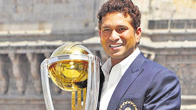 Sachin Tendulkar with the World Cup 2011 trophy in Mumbai.(AP photo)