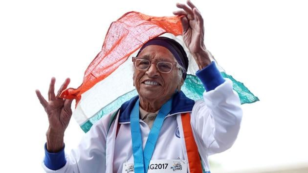 101-year-old Mann Kaur from India celebrates after competing in the 100m sprint in the 100+ age category at the World Masters Games at Trusts Arena in Auckland on Monday.(AFP)