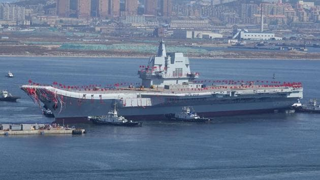 China's first domestically-built aircraft carrier is seen during its launching ceremony in Dalian, Liaoning province.(Reuters Photo)