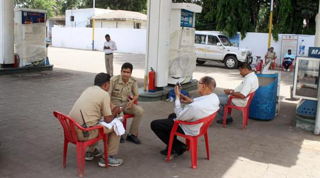 Seven petrol pumps were sealed in Lucknow on Thursday after raids by the special task force found electronic chips attached to fuel dispensing machines which gave out a less amount of petrol than what customers were being charged for.(PTI Photo)