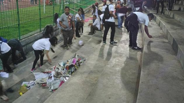 Aizawl FC fans clean up the Shillong Lajong stadium on Sunday after their team won the I-League football championship to become the first from North-East India to clinch the coveted national crown(Ricky Renthlei)