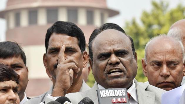 File photo of Calcutta high court judge CS Karnan addressing the media outside the Supreme Court.(HT Photo)