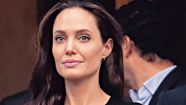 Angelina wants to know exactly what Brad is up to at all times, say reports.(Getty Images)