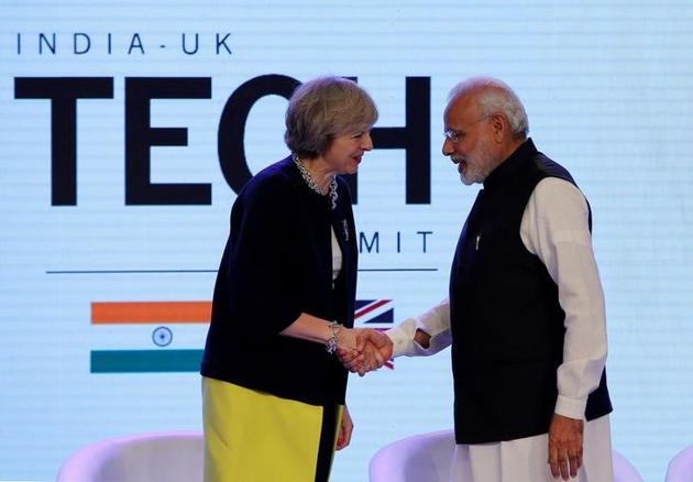 British Prime Minister Theresa May with Prime Minister Narendra Modi during the India-UK Tech Summit in New Delhi in November.(Reuters File)