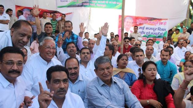 Former chief minister Harish Rawat at the Congress dharna to protest against the PDS foodgrain price rise in Dehradun on Monday.(Vinay Santosh Kumar/HT Photo)