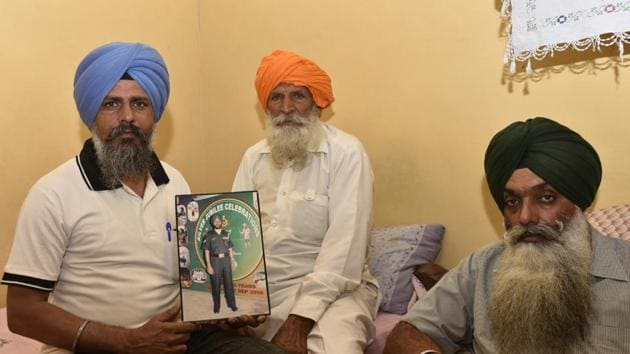 Udham singh (centre), father of naib subedar Paramjit Singh, and other family members at their residence in Vein Poin village of Tarn Taran district on Monday, May 1.(Gurpreet Singh/HT)