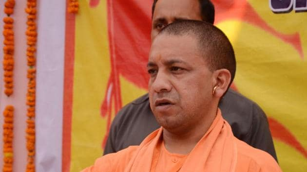 Yogi Adityanath attends a function at RSS office Madhavdham, in Gorakhpur.(PTI File Photo)