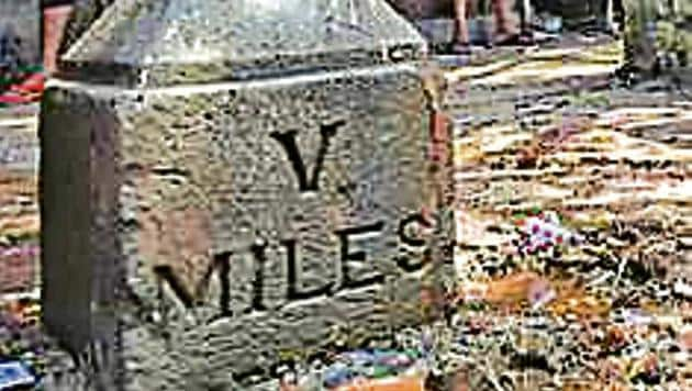 The Parel milestone was found in April near KEM hospital by BMC workers clearing the footpath of encroachments. It has the Roman numeral V (5) written on it, and the word 'MILES'.(HT file photo)