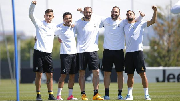 Juventus players pose for the camera during training, ahead of their UEFA Champions League semifinal first leg clash against Monaco on Tuesday.(AFP)
