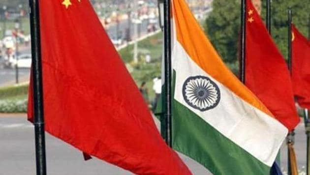 """The national flags of China and India at Vijay Chowk on Rajpath. The Chinese state media has indicated that China appears not to """"interfere"""" in the internal affairs of other countries but its investments, for example in the CPEC, gives Beijing the perfect cover to launch its diplomatic game.(HT File Photo)"""