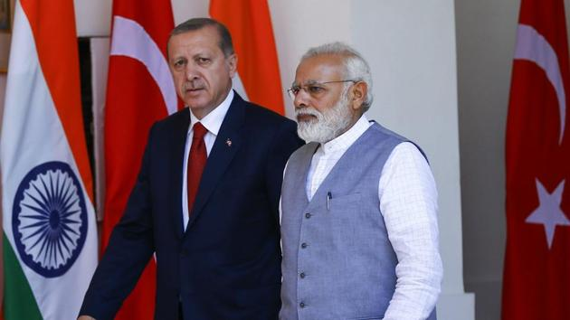 Indian Prime Minister Narendra Modi, right, and Turkish President Recep Tayyip Erdogan walk prior to their meeting in New Delhi.(AP)