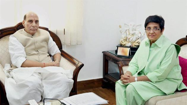 Union home minister Rajnath Singh and lieutenant governor of Puducherry Kiran Bedi during a meeting in New Delhi on Tuesday.(PTI Photo)