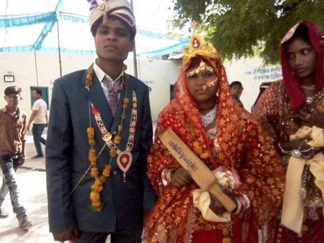 "A mass-marriage ceremony was hosted by Gopal Bhargava, state minister of panchayati raj and rural development, in his hometown of Garhakota on Saturday. Bhargava made sure the messages were inscribed loud and clear on the traditional laundry bats used to thrash the grime out of dirty clothes: 'A gift to be used for bashing drunkards' and 'The police won't intervene!""(HT Photo)"