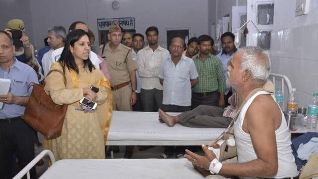 District magistrate Ministi S interacts with a patient at the district hospital during an inspection on Wednesday.(Sakib Ali/HT Photo)