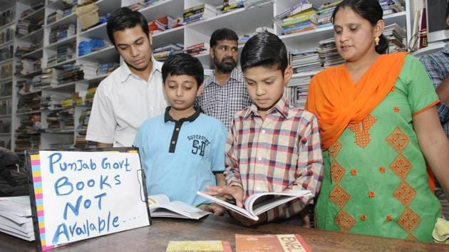 A notice informing about non-availability of Punjab school textbooks at a shop in Patiala.(Bharat Bhushan/HT Photo)