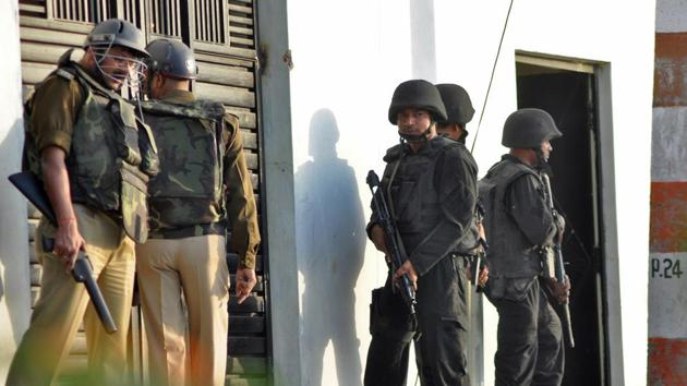 Representative Image: Anti Terrorist Squad (ATS) commandos and local police stand guard outside a house where a suspected militant is said to be hiding in Thakurganj area in Lucknow, in this file photo from March.(REUTERS)