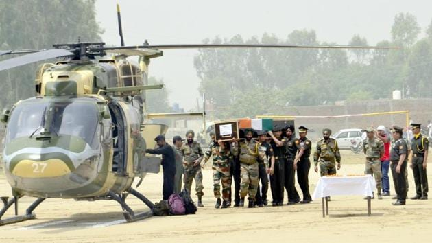 Indian Army personnel carry the coffin of Indian Army soldier Paramjeet Singh ahead of his funeral at Vein Pein village, some 45kms from Amritsar on May 2, 2017. The Indian army accused Pakistan of killing two of its soldiers and mutilating their bodies in an 'unprovoked' rocket and mortar attack along the border on Monday morning.(Sameer Sehgal/Hindustan Times)