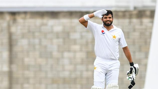 Azhar Ali of Pakistan cricket team celebrates after completing his century during Day 3 of the 2nd Test against West Indies cricket team at Kensington Oval, Bridgetown, Barbados, on Tuesday. Get cricket score of West Indies vs Pakistan, 2nd Test, Day 3 here.(AFP)