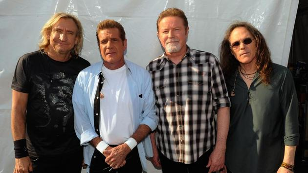 This file photo taken on May 4, 2012 shows Joe Walsh, Glenn Frey, Don Henley and Timothy B. Schmit of the Eagles backstage during the 2012 New Orleans Jazz & Heritage Festival - Day 6 at the Fair Grounds Race Course in New Orleans, Louisiana.(AFP)