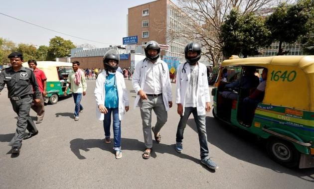 Doctors wear crash helmets outside the All India Institute Of Medical Sciences (AIIMS) during a protest to highlight the lack of security offered to doctors, in New Delhi, March 23(REUTERS)