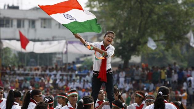 A school girls waves the Indian national flag as she performs on the occasion of 69th anniversary of India's independence from British rule, in Jammu, India, Saturday, Aug. 15, 2015.(AP Representative Photo)