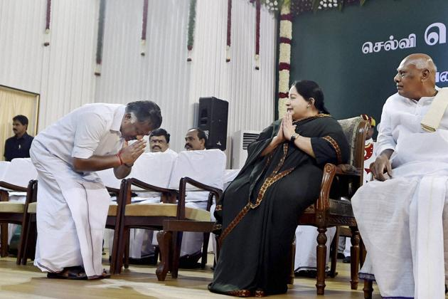 O Panneerselvam greeting AIADMK supremo J Jayalalithaa ahead of taking the oath of secrecy as Finance Minister at the swearing in ceremony at Madras University Centenary Auditorium in Chennai on 23 May 2016.(R Senthil Kumar/PTI)