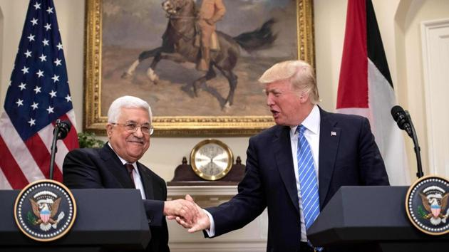 US President Donald Trump and Palestinian Authority President Mahmud Abbas shake hands in the Roosevelt Room during a joint statement at the White House in Washington on Wednesday.(AFP)