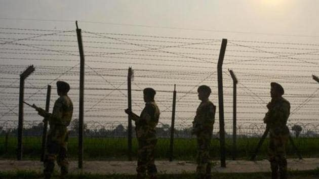 Security personnel patrolling along a fence at the India-Pakistan border, at Wagah.(AFP File Photo)