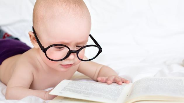 Children whose parents have conversations with their children about the book while reading, such as labelling the pictures or the emotions of the characters in the book are more likely to have early reading skills as well as literacy skills.(Shutterstock)