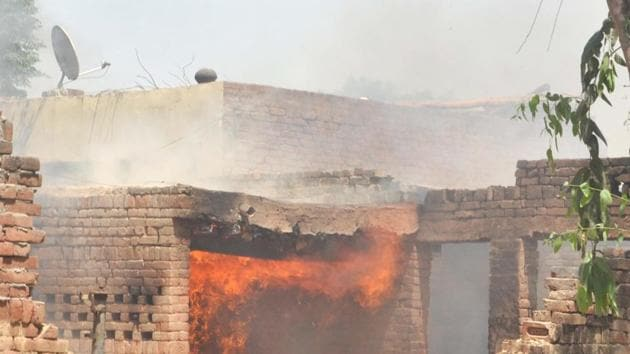 An altercation ballooned into a full-blown clash with both groups throwing stones and bricks at each other.(HT Photo)