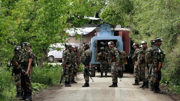 Army personnel take position during a search operation at a village in Shopian district in Kashmir.(PTI)