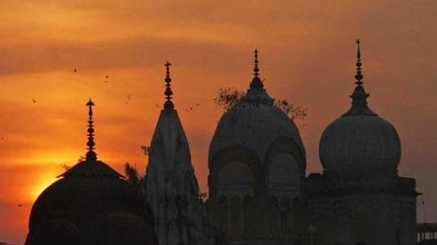 Birds fly at sunset over a temple in India.(AP Photo/Representative image)