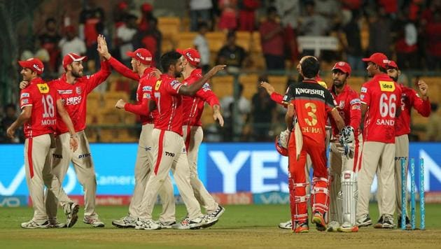Kings XI Punjab (KXIP) players celebrate their 19-run win in the 2017 Indian Premier League (IPL) match against Royal Challengers Bangalore (RCB) at the M Chinnaswamy Stadium in Bangalore on Friday.(BCCI)