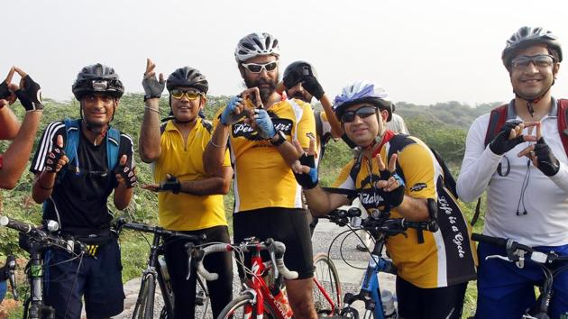 Members of Pedalyatri pose after a successful trail.(Sanjeev Verma/ HT Photo)