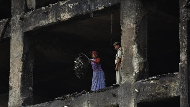 On April 19, six people, including a visitor and a managing director of a factory in Noida that was operating in violation of building bylaws and land-use norms, died in a fire.(Virendra Singh Gosain/HT Photo)