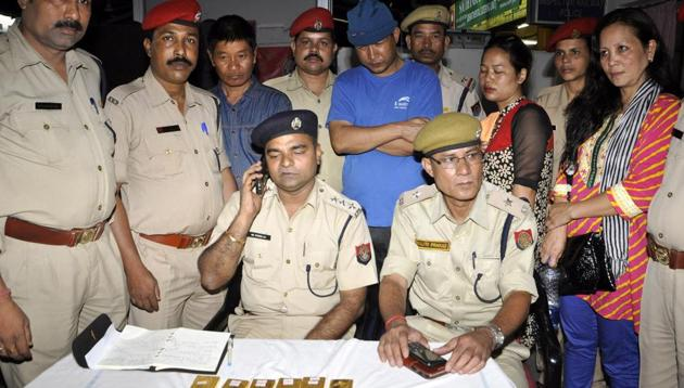 Railway police present four people, including two women, arrested with 20 kg of gold before the media at the Guwahati station on Friday.(Rajib Jyoti Sarma)