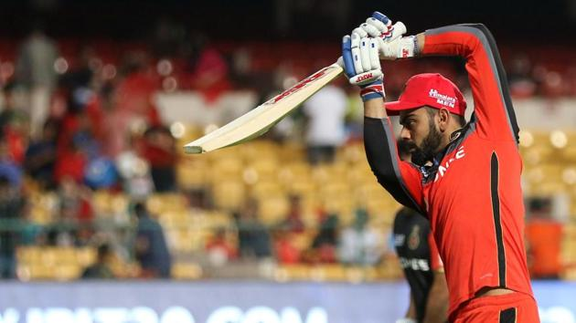 Royal Challengers Bangalore captain Virat Kohli warms up before Friday's IPL 2017 match vs Kings XI Punjab at Chinnaswamy Stadium. Get IPL 2017 live cricket score of RCB vs KXIP here(BCCI)