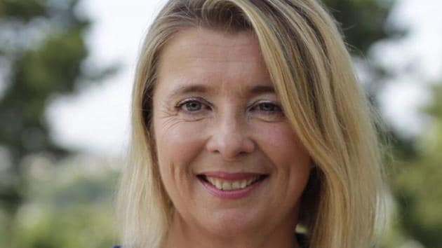 Corinne Erhel, 50, was the last to speak at the rally Friday in western France when she suddenly fell to the ground. She was rushed to hospital, where she was pronounced dead.(Twitter Photo)