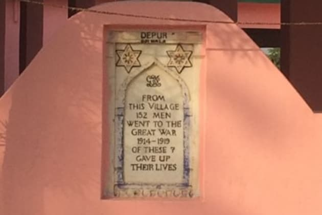 A message written on a memorial that is fixed outside the wall of a temple in Hoshiarpur's Depur village.(HT Photo)