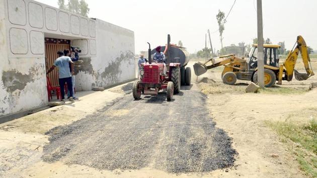 Repairs underway on a road in Vein Poin village in Tarn Taran district on Saturday, May 6.(Sameer Sehagl/HT)