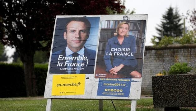 French presidential candidate Emmanuel Macron (left) has said his campaign has been the target of a computer hack.(REUTERS)