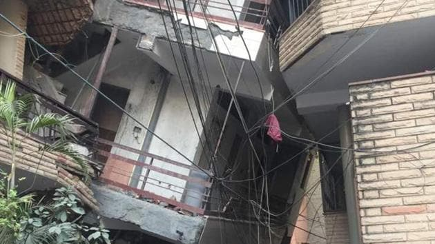 The under-contruction building collapsed on to another in Inderpuri in west Delhi, trapping five people who were rescued later.(HT PHOTO)