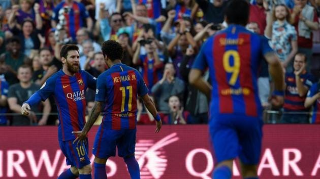 FC Barcelona forward Lionel Messi (left) celebrates with teammate Neymar (centre) after scoring during the Spanish La Liga match vs Villarreal CF at the Camp Nou stadium in Barcelona on Saturday.(AFP)