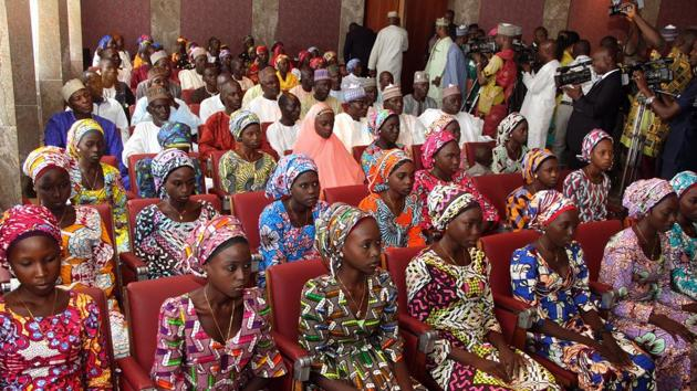 This file photo taken on October 19, 2016 shows 21 Chibok girls who were released by Boko Haram a week before, attending a meeting with the Nigerian President at the State House in Abuja, Nigeria.(AFP)