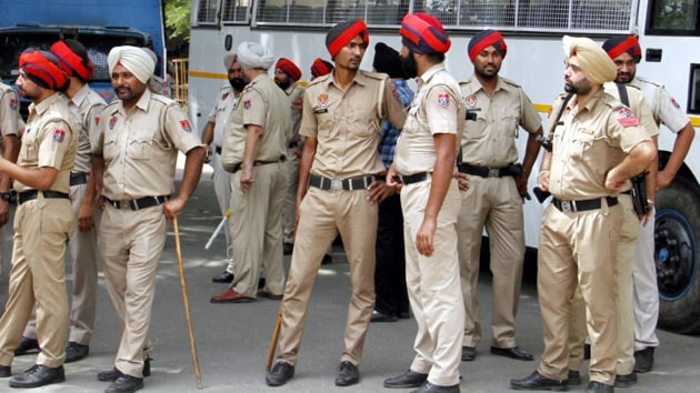 Policemen wearing low-waist pants with a tighter fit in Ludhiana on Wednesday.(JS Grewal/HT Photo)