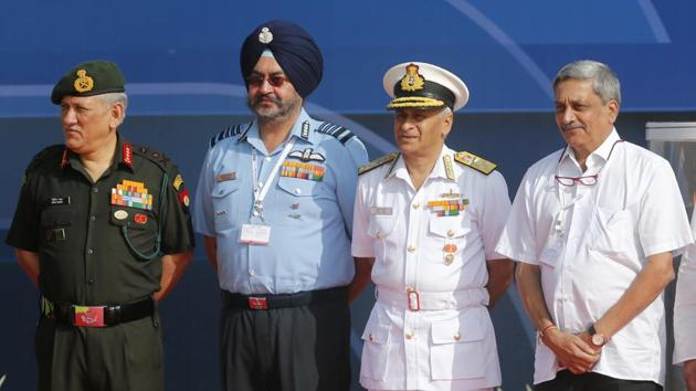 Former defence minister Manohar Parrikar with the chiefs of the Army, Navy, and Air Force, Bangalore, February 2017.(AP)