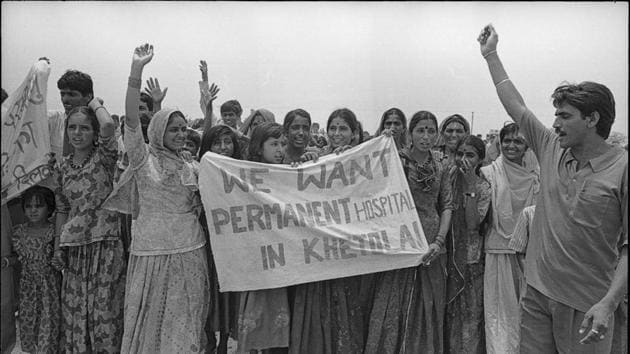 People of the Khetolai village in Pokhran,Rajasthan protest demanding a hospital in 1998. There have been reports of cancer, tumour and rashes due to the radioactive contamination near the blast sites. (Arun Jetlie./HT Photo)